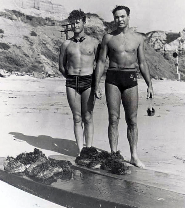 "1938 abalone dive near Calafia Street in San Clemente, CA. That's Tommy Smith and Charles ""Doaks"" Butler (an M.D., Doakes went on a destroyer as Medical Officer and was killed during the War). In those years the abalone were thick. In eight feet of water you could get all you wanted. This was the year before find (Churchill's) first came out."