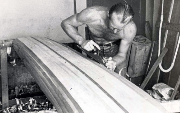 Circa '38-'39, Pete's shaping my board at his garage on 17th St. in Santa Monica. I was standing there urging him to hurry so we could get a couple of coats of varnish on it cause the surf was coming up.