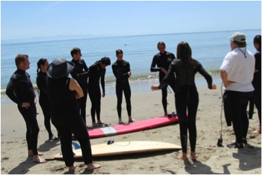 Michael Allen instructing prior to doing the water rescue using a longboard as a backboard for spinal stabilization for a surfer with a possible spinal injury. Photo by Julie Allen