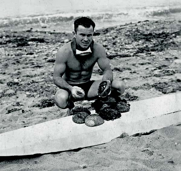 Doc with abs on 12' paddleboard that preceded Wonderboard, c.1933.