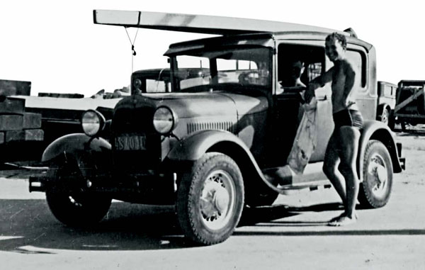 """Doc and LeRoy in the parking lot at Long Beach Flood Control, circa late 1930s. That's Doc's 14' H&H paddleboard on the roof of his '31 Model A. We called it the """"Wonderboard"""" because it was so easy to paddle. With that board Doc caught waves way outside of us. (captions by LeRoy Grannis)"""