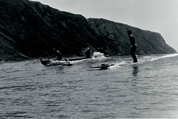 Doc at the Cove, coming in on Wonderboard with abalone catch, c. 1935.