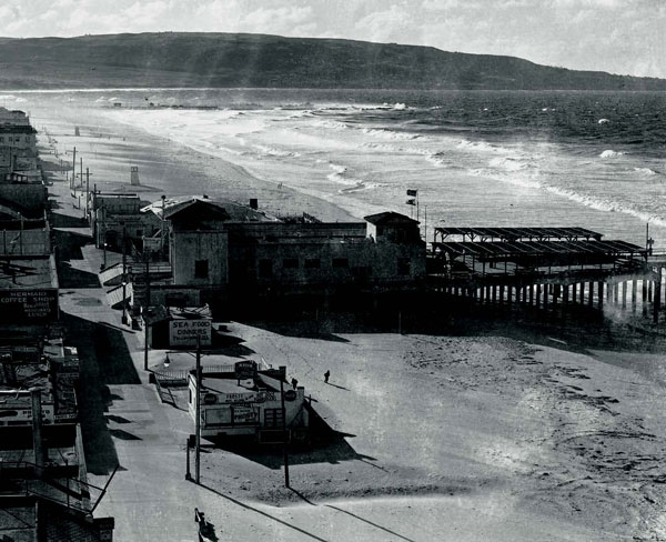 Late 1930s, looking south from Hermosa Pier on a receding tide that had risen so high it swept over the beach and into town, clear to Pier Ave.