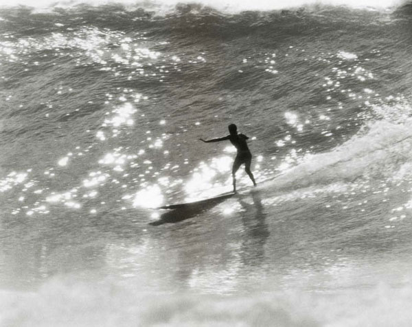 1956, George Downing in Makaha point surf. Downing, Woody and Wally were the top big wave riders. All the California guys would follow them around and get advice. This was before Waimea had been ridden and Makaha was the premiere big wave, the ultimate goal.